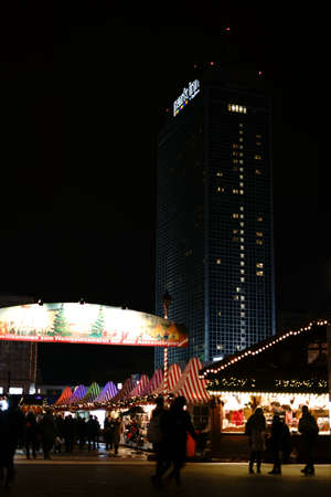 Berlin, Germany - December 05, 2017: The Christmas market at Alexanderplatz with the Park Inn Hotel in the night on December 05, 2017 in Berlin. Editorial