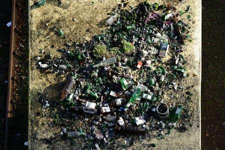 Bottle garbage drunken beer bottles lies on an intermediate roof in a party zone.