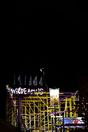 Berlin, Germany - December 05, 2017: A colorfully lit Wild Mouse roller coaster at the Christmas Market at night on December 05, 2017 in Berlin.