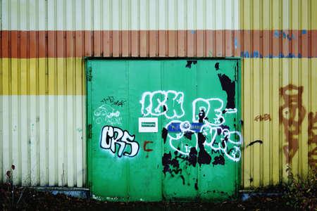 A graffiti painted steel door or fireproof door and emergency exit.