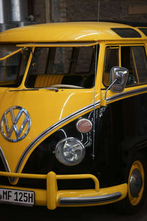 Mainz, Germany - November 04, 2017: The front view with windscreen and logo of an old black yellow VW Bus vintage car on November 04, 2017 in Mainz.