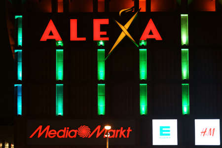 Berlin, Germany - January 03, 2018: The colorful neon lights, logos and advertisements of the Alexa department store on Alexanderplatz on the night of January 03, 2018 in Berlin. Editorial