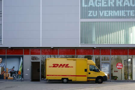 Mainz, Germany - November 14, 2017: A parcel delivery and delivery vehicle from DHL deliver packages on November 04, 2017 in Mainz.