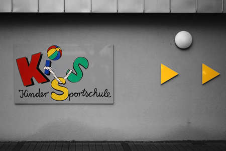 Weinheim, Germany - November 25, 2017: The colorful logo of the childrens sports school Weinheim at the hall of the Hector Sports Center on November 25, 2017 in Weinheim.