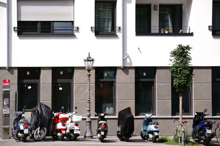 Mainz, Germany - August 21, 2017: Scooters and bicycles and parking on a residential building at the Holzhof Street in downtown Mainz on August 21, 2017 in Mainz.