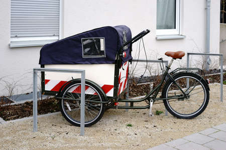 A cycle rickshaw as a means of transporting children with a covered child seat.