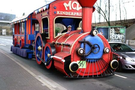 Mainz, Germany - February 10, 2018: A locomotive-like vehicle with trailers for city tours goes to carnival time for children on February 10, 2018 in Mainz. Editorial