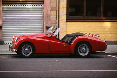 Mainz, Germany - August 21, 2017: The side view of a red Triumph TR 3A roadster sports car and classic car on August 21, 2017 in Mainz.
