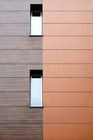 The modern facade of a building with noble wood paneling.                               写真素材