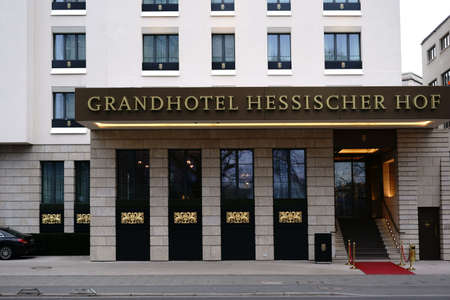 Frankfurt, Germany - March 02, 2018: The luxury and gold-decorated entrance facade of the Grand Hotel Hessischer Hof is a 5-star luxury hotel on March 02, 2018 in Frankfurt.