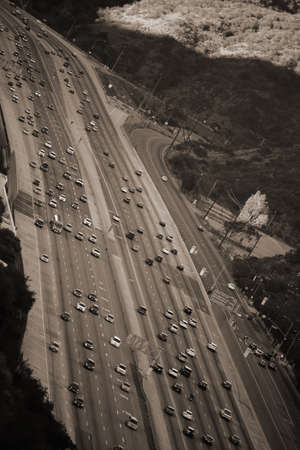 Traffic on the San Diego Freeway in Los Angeles with the Getty Center.