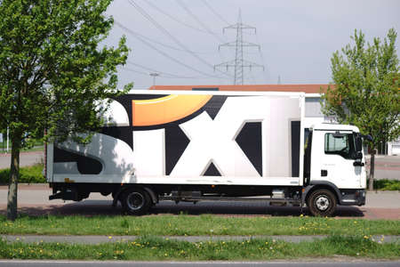 Weiterstadt, Germany - April 22, 2018: A lorry of the Sixt car rental company is in the shadow of a parking lot on April 22, 2018 in Weiterstadt.
