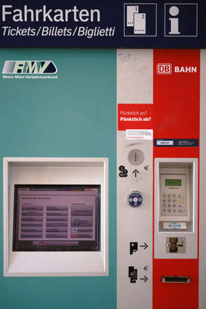 Weiterstadt, Germany - April 22, 2018: A ticket vending machine of the Rhine-Main Transport Association (RMV) with a digital display and coin slot on April 22, 2018 in Weiterstadt. Editorial