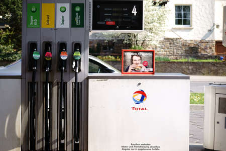 Taunusstein-Wehen, Germany - April 21, 2018: Several petrol pumps for refueling of super unleaded, diesel and environmentally friendly E10 at a Total gas station on April 21, 2018 in Taunusstein-Wehen.