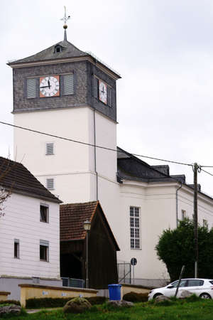 The white clock tower of the Evangelical Church in Taunusstein-Wehen.
