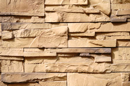 A wall decoration made of staggered and broken clinker bricks.
