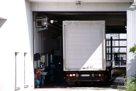 A garage with a brake tester for trucks.