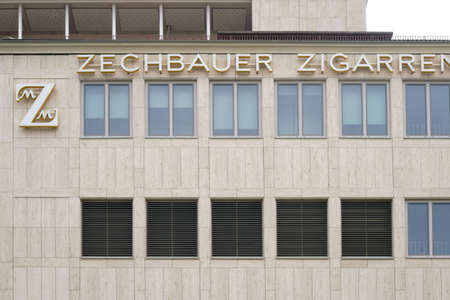 Munich, Germany - June 30, 2018: The logo of the cigar dealer Zechbauer on the outside facade of the cigar shop on June 30, 2018 in Munich.