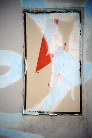 Close-up of a demolished lightning bolt symbol on the surface of a painted electrical distributor. Stock Photo