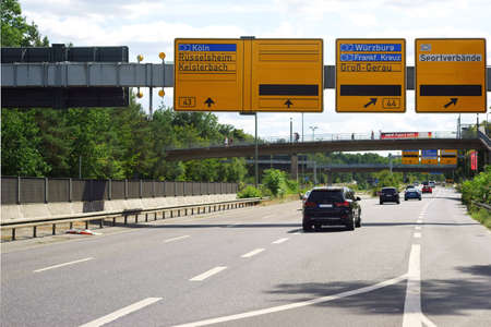 A section of the A44 motorway with flowing traffic near Frankfurt with departures to Munich and Cologne.