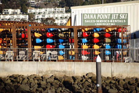 A boat with piled up boulders in the docks of Dana Point. Editorial