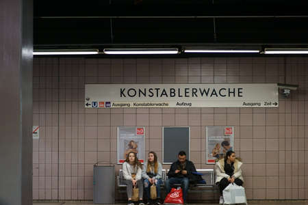 Frankfurt, Germany - March 02, 2019: People sit on the grid at the subway station Konstablerwache on March 02, 2019 in Frankfurt. Sajtókép