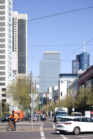 Frankfurt, Germany - April 18, 2019: Various skyscrapers as the Westend Tower and the Deutsche Bank skyscraper in the background at Westend Street on April 18, 2019 in Frankfurt.