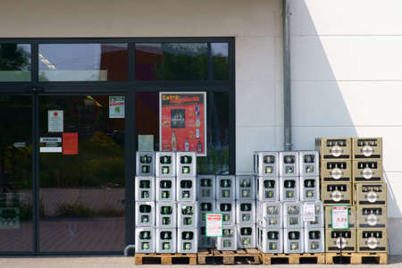 Mainz, Germany - May 24, 2019: Beverage boxes of various mineral water producers in front of the entrance of the professional beverage shop on May 24, 2019 in Mainz. Sajtókép