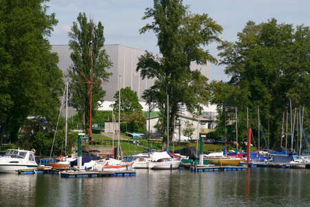 A sailboat harbor with sailboats in an inland harbor on the river Rhine.