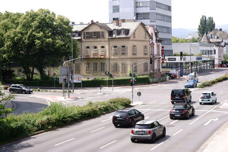 Bad Homburg, Germany - May 19, 2018: A traffic light crossing at the Hessenring in Bad Homburg with adjoining residential buildings and commercial buildings on May 19, 2018 in Bad Homburg.