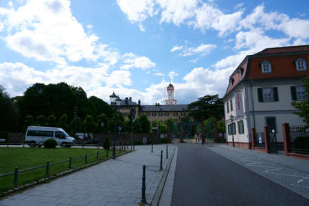 Bad Homburg, Germany - June 09, 2019: The gate of the castle Homburg Seat and residence of the country with the white tower visible from far away on June 09, 2019 in Bad Homburg.