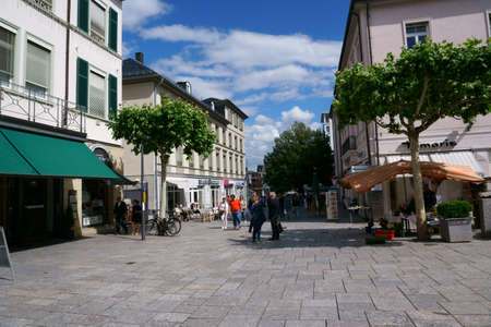 Bad Homburg, Germany - June 09, 2019: passers-by and pedestrians in the shopping area of Luisenstrasse in the city center with department stores and shops on June 09, 2019 in Bad Homburg.