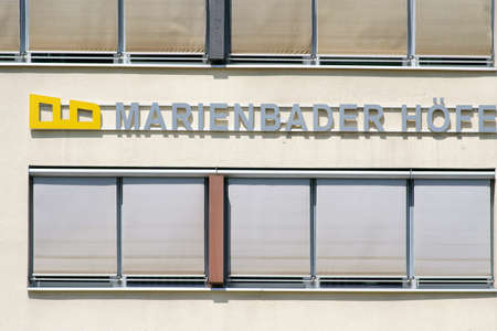 Bad Homburg, Germany - June 09, 2019: The logo of the residential and office complex Marienbader Hoefe in the city center on June 09, 2019 in Bad Homburg. Sajtókép