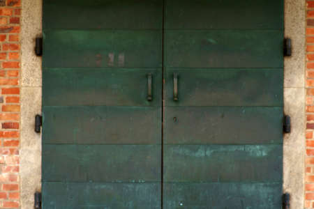A heavy church door and sliding bronze with patina.