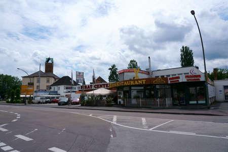 Hanau, Germany - June 16, 2019: Turkish restaurant, shops and a barber shop near the main train station on June 16, 2019 in Hanau. Sajtókép