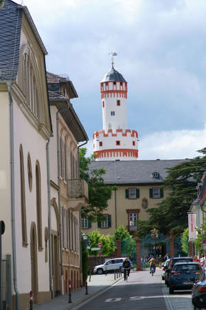 Bad Homburg, Germany - June 09, 2019: The narrow Dorotheenstrasse with the gate entrance of the castle Homburg seat and residence of the landgrave as well as the far visible white tower at its end on 09 June 2019 in Bad Homburg.
