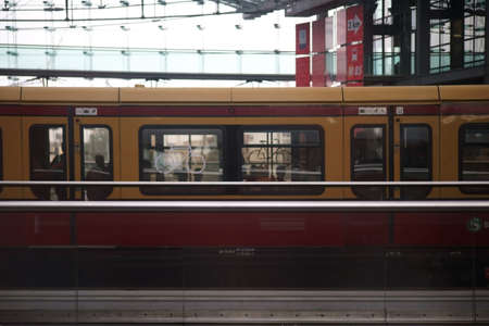 The side view of the body of a city train in the Berlin East railway station.