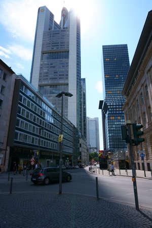 Frankfurt, Germany - July 06, 2019: Various skyscrapers like the Commerzbank skyscraper in the city center backlight on 06 July 2019 in Frankfurt. Sajtókép