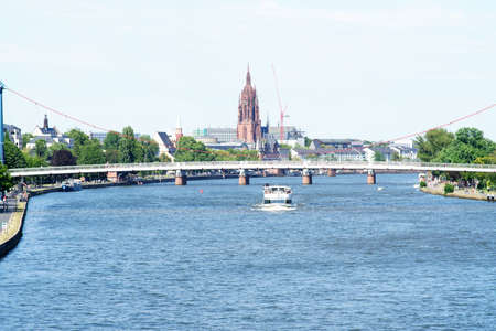 The view over the river Main in Frankfurt with the cathedral and the old town in the background.