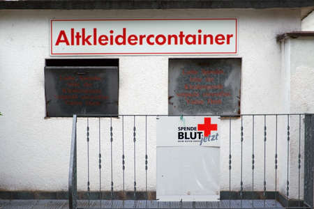 A container for clothing donations and blood donations of the aid organization Red Cross. Stock fotó