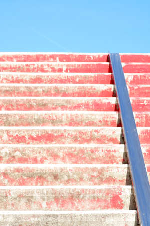 The closeup of red stairs with a bicycle rail. Reklamní fotografie