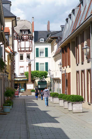 Bad Homburg, Germany - June 09, 2019: A narrow alley with old historic houses overlooking the orphanage Square on June 09, 2019 in Bad Homburg.