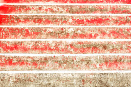 The close-up of the surface of red stairs.