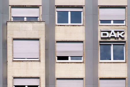Giessen, Germany - August 13, 2019: DAK on the facade of an office and business building on August 13, 2019 in Giessen. Editorial