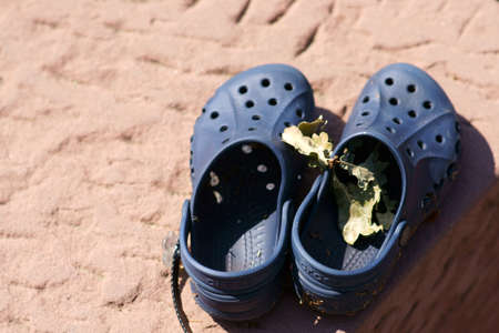 Two forgotten and left childrens shoes or sandals. Reklamní fotografie