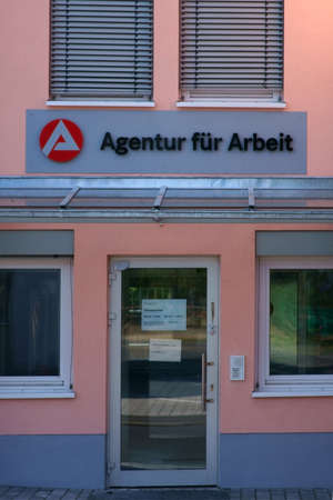 Alzenau, Germany - August 24, 2019: The glass entrance of the business building of the agency for work on August 24, 2019 in Alzenau.