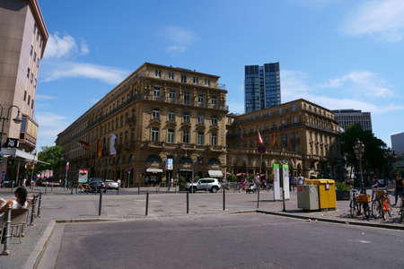 Frankfurt, Germany - July 06, 2019: The Imperial Square in the city center with the Hotel Steigenberger Frankfurter Hof as well as shops and commercial buildings on 06 July 2019 in Frankfurt. Editorial