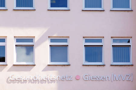 Giessen, Germany - August 13, 2019: The logo of the Medical Care Center MVZ at a business building on August 13, 2019 in Giessen.