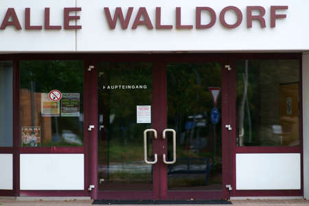 Walldorf, Germany - August 11, 2019: Walldorf with a glass door and advertising posters on August 11, 2019 in Walldorf.