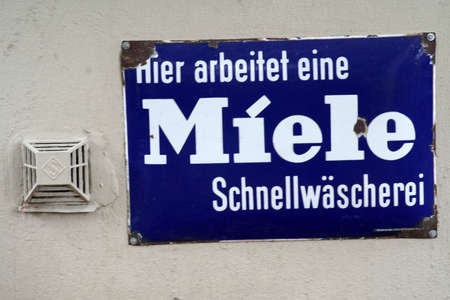 Bad Vilbel, Germany - September 08, 2019: The rusted vintage sign of a laundry with a Miele logo on September 08, 2019 in Bad Vilbel.